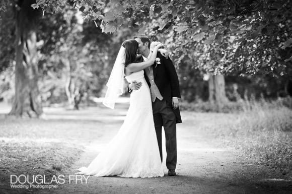 Wedding photograph of couple kissing at fulham palace