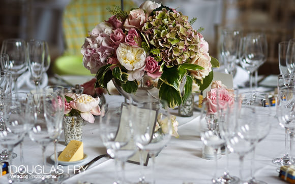 Table settings and flowers on tables at wedding in London