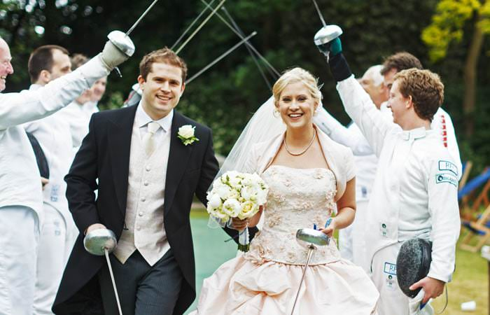 Wedding Photograph - Bride and Groom with Swords at Hurlingham Club, Fulham, London