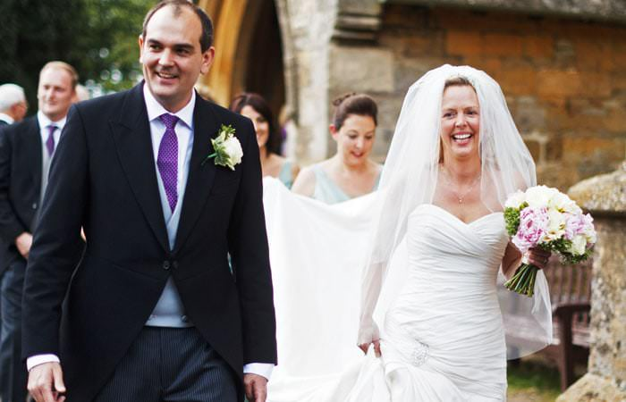 Wedding Photographer - bride and groom outside church in Stow-on-the-Wold