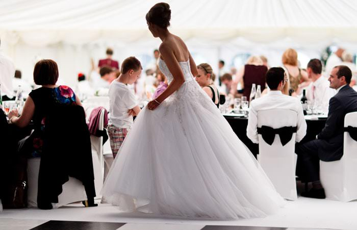 Wedding Photograph of Bride in Marque at Cobham Hall, Kent