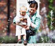 baby next to fountain during wedding reception at Fulham Palace in London - wedding photograph by Douglas Fry