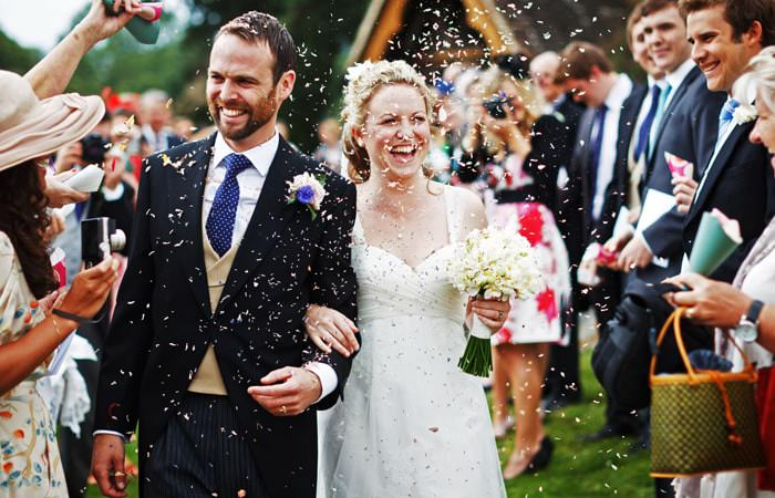 Wedding Photograph Bride and Groom with Confetti Surrey