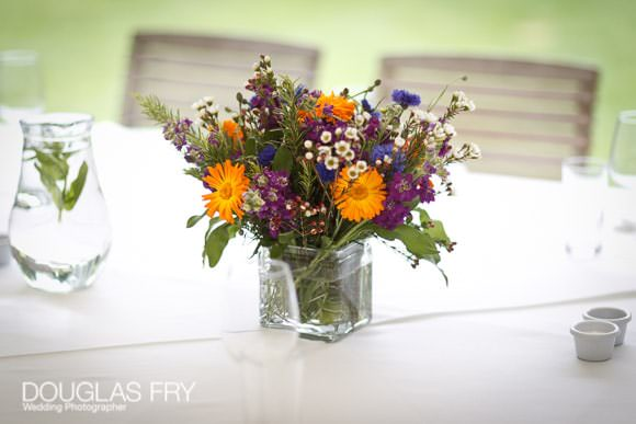 Flowers on table during wedding reception