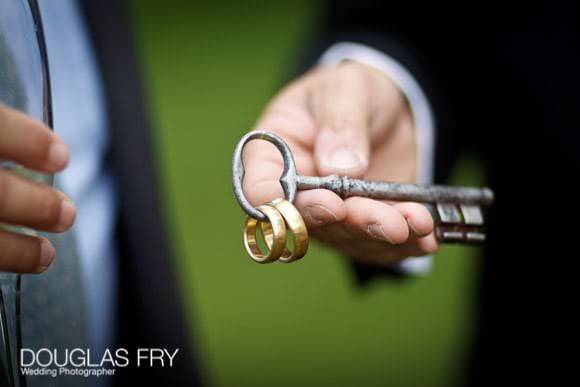 keys with wedding rings photographed