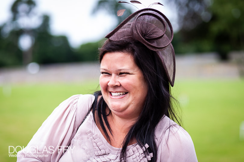 Wedding photograph of smiling guest at Coworth Park