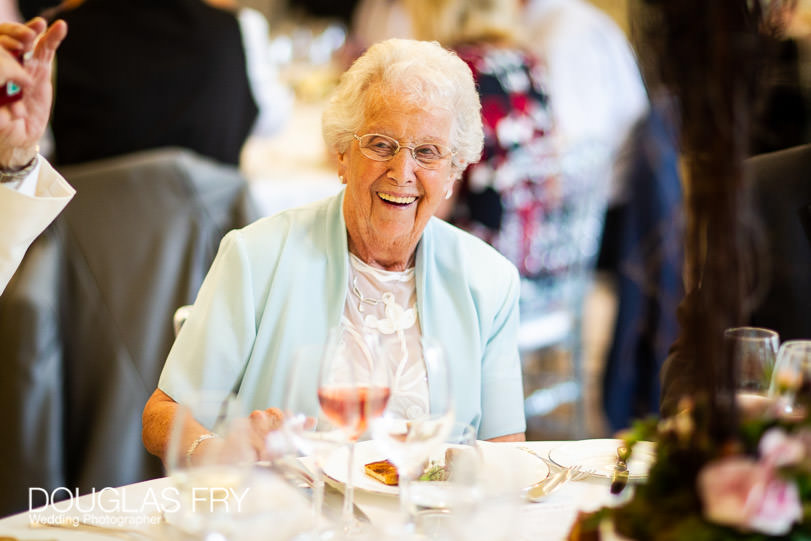 Guests laughing during wedding reception at Coworth Park