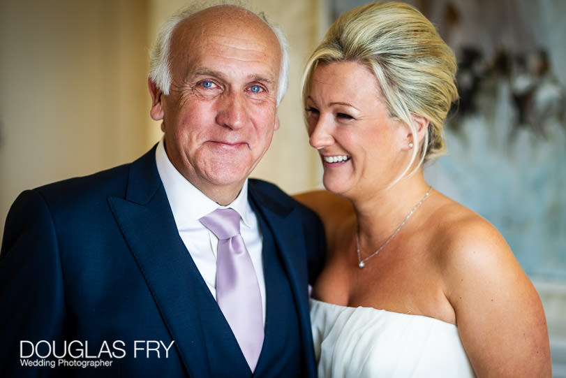 Father with the bride getting ready at Coworth Park