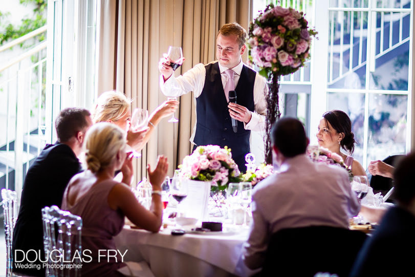 raising a toast during wedding at Coworth Park