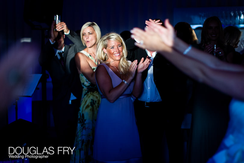 Guests dancing during wedding at Coworth Park