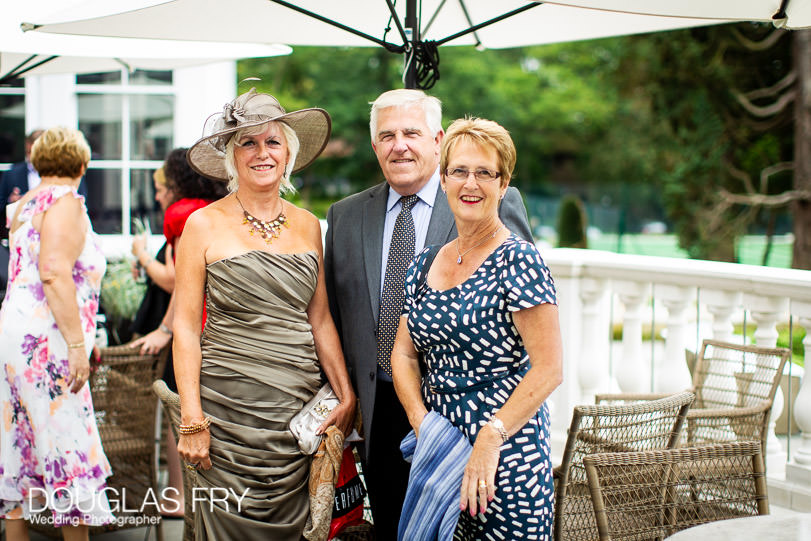 Guests arriving at Coworth Park for wedding