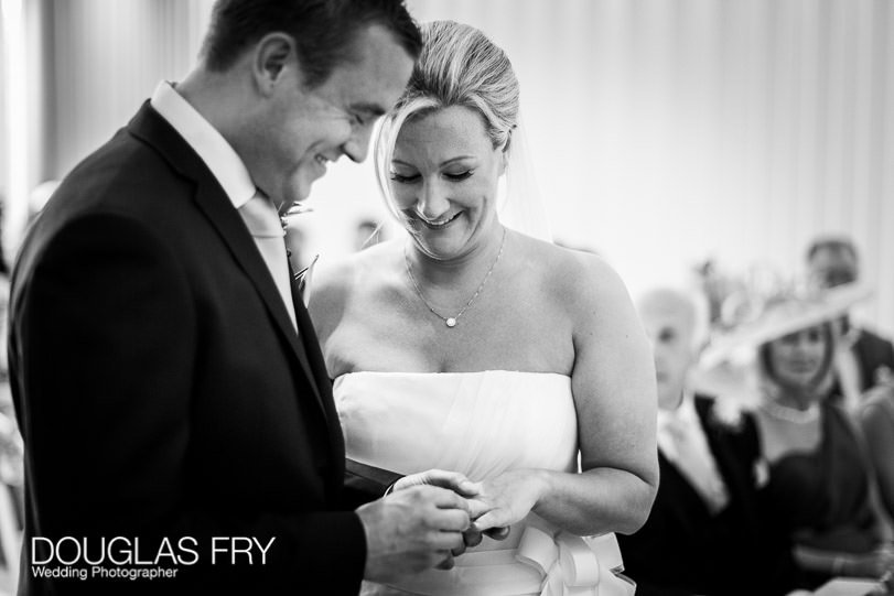 Bride and groom photographed during wedding ceremony at Coworth Park Ascot