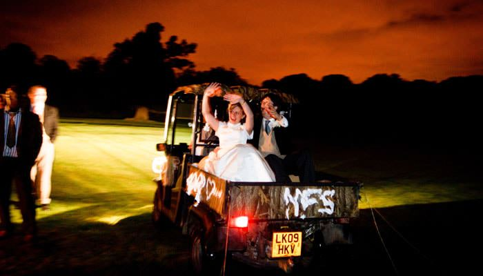 Wedding Photograph at Michlefield Hall, Hertfordshire - Going Away in Car