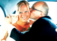 Bride and groom kiss in back of London cab