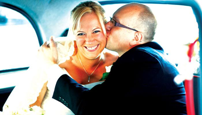 Photograph of Wedding Couple in Taxi