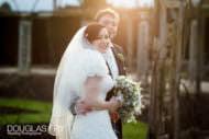 Great Fosters wedding photographer - couple on bridge
