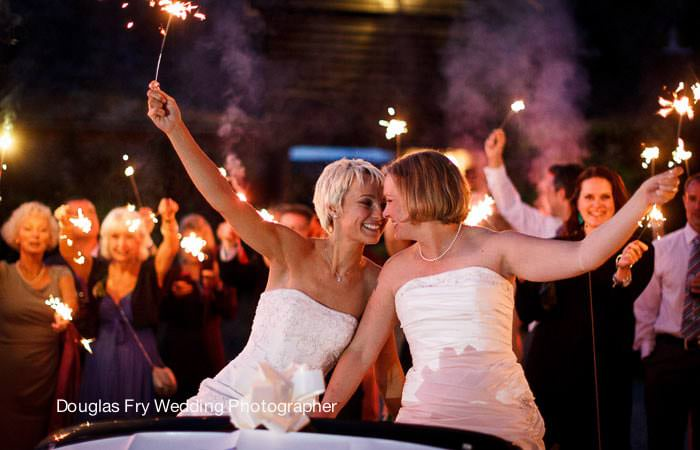 Photograph of brides in car with sparklers  Sussex