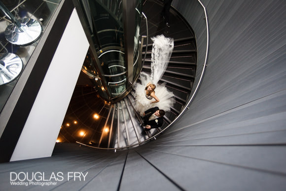 Bride and groom photographed on stair case at Gherkin