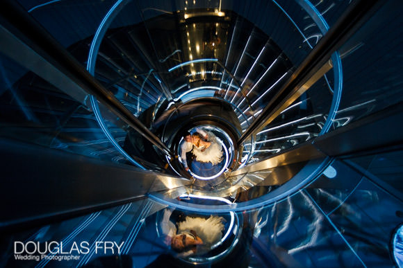 Staircase at Gherkin - couple photographed looking down.