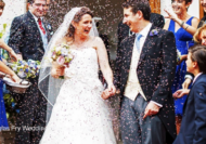 Wedding photograph of bride and groom leaving Gray's Inn with confetti on wedding day