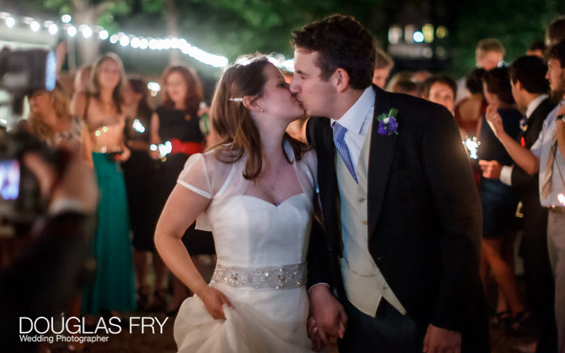 couple leaving Grays Inn at end of London wedding