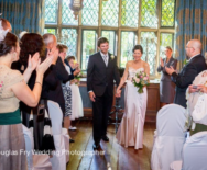 Couple leaving ceremony at Great Fosters