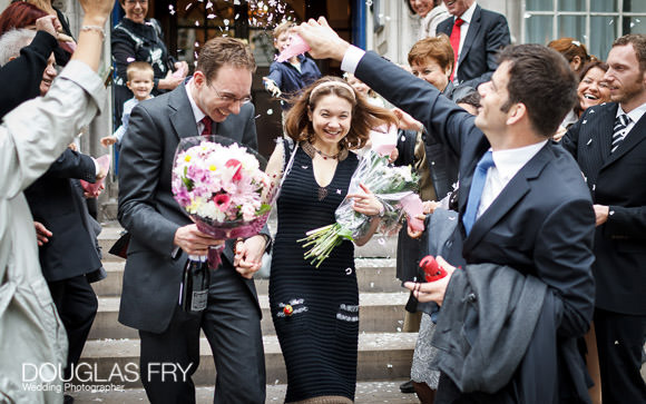 The Steps of Chelsea Town Hall - couple photographed with confetti
