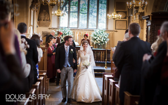 couple in aisle at Chelsea Old Church