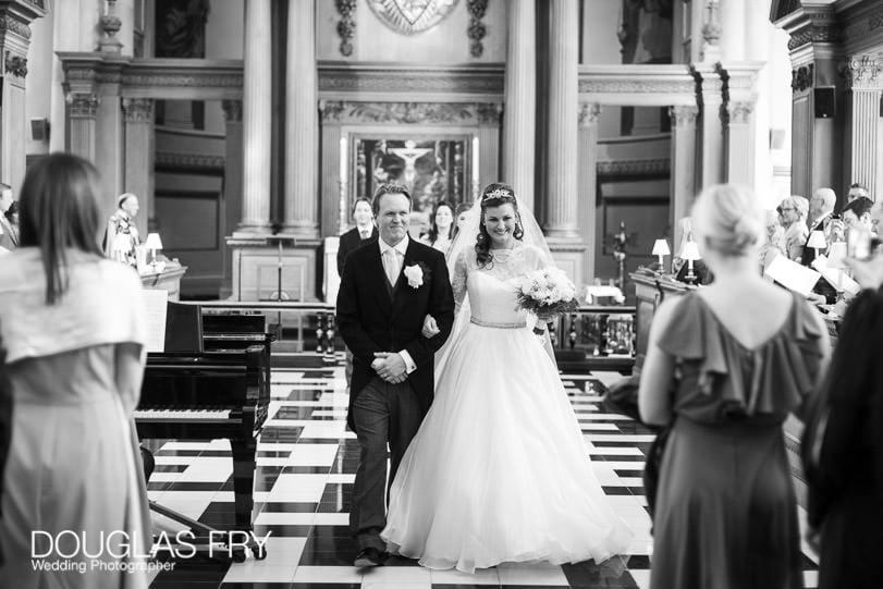 Wedding Photographer St Brides Church London - leaving the church