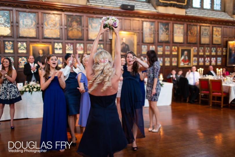 Wedding Photographer Lincolns Inn London - throwing the bouquet