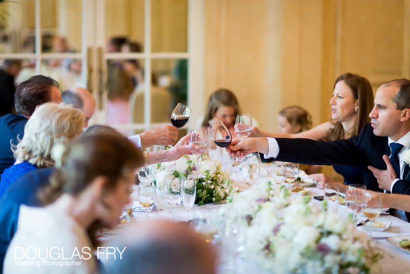 Wedding Photographer Mandarin Oriental Hotel - toasting the couple