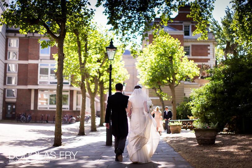 Couple walking in London streets - wedding photographer London