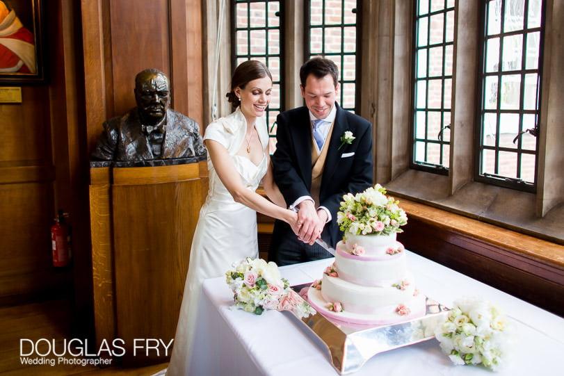 Couple cutting wedding cake at Grays Inn London