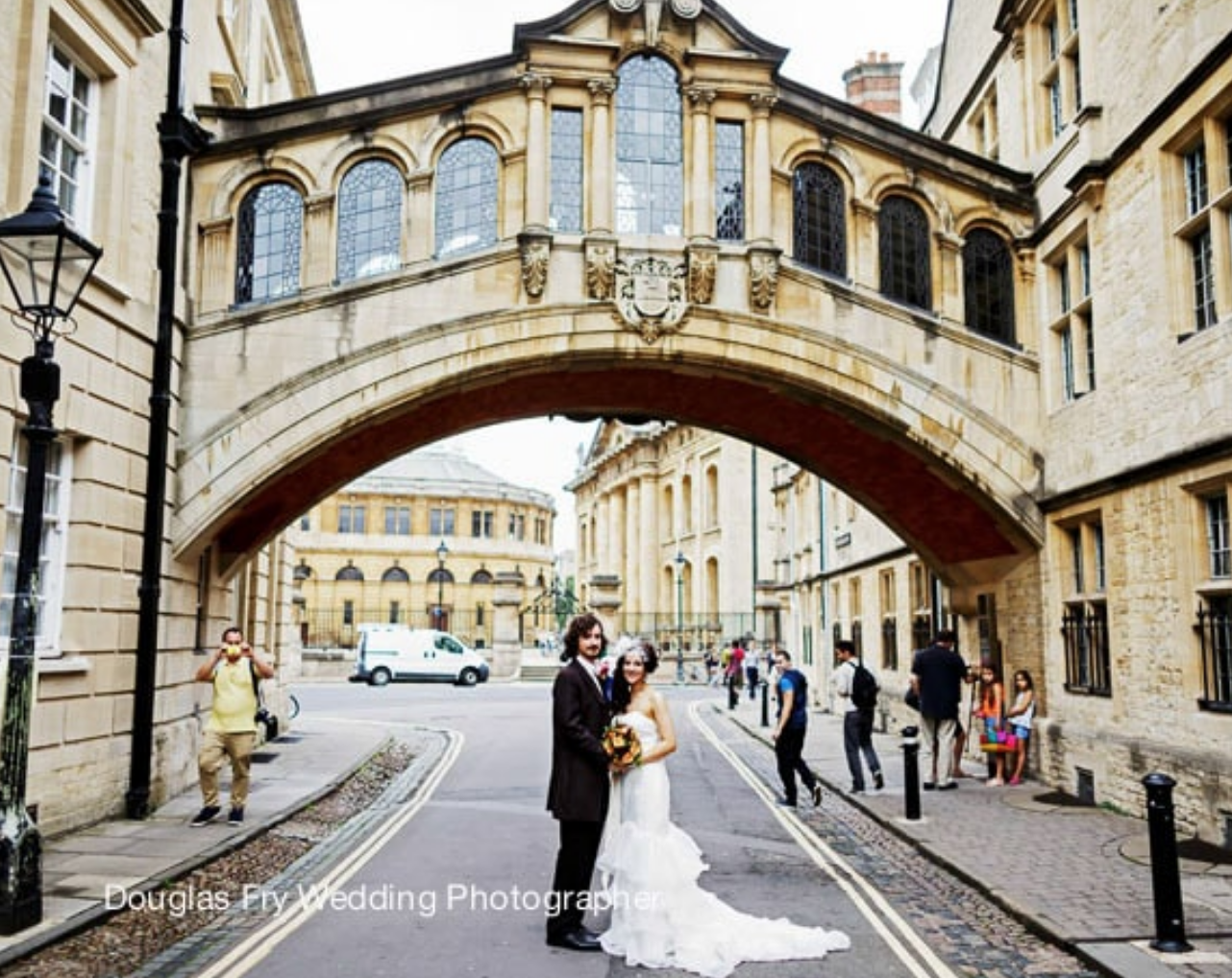 Couple photographed beneath the bridge of Sighs in Oxford