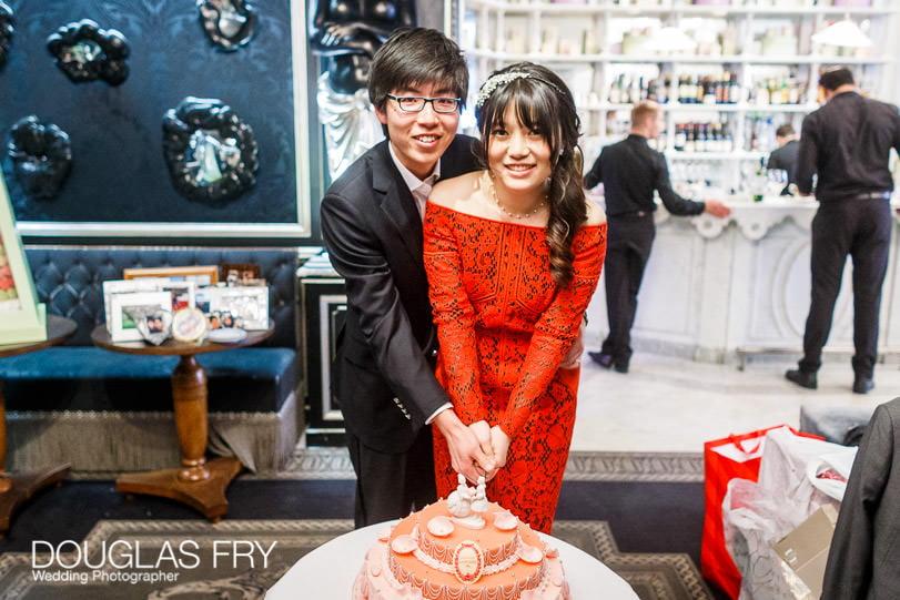 Cake cutting at Harrods wedding