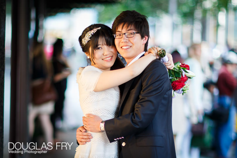 Couple photographed outside Harrods in Knightsbridge on wedding day