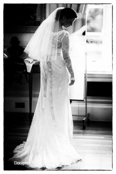 Wedding Photograph taken of bride getting ready in black and white