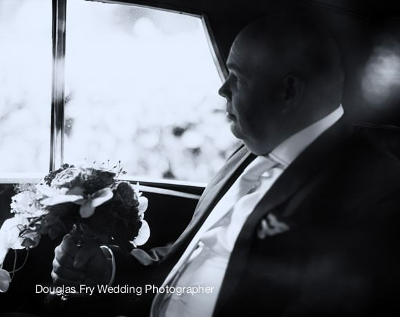 Groom in car - black and white