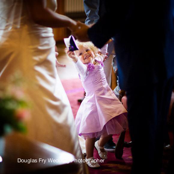 Bridesmaid at wedding ceremony