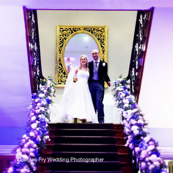 Wedding Photograph going away from hotel in London