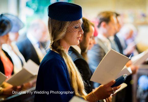 Leica Wedding Photographer London - photograph of guest in church