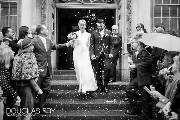 Wedding Photograph on the steps of Chelsea Register Office, Kings Road with confetti