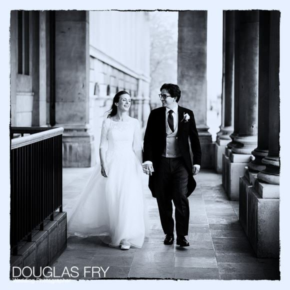 The bride and groom walking along at Greenwich - Black and white photograph