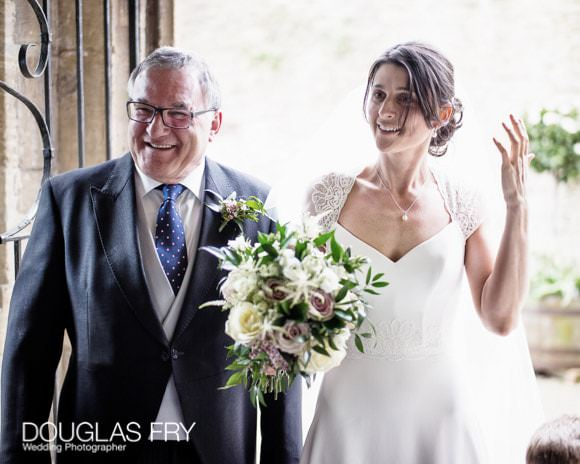 Bride and Father in doorway to church