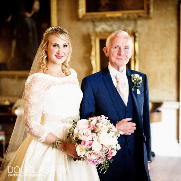 Bride with her father entering Syon Park