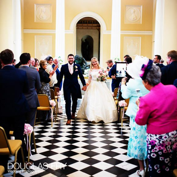 Bride and groom leaving the wedding ceremony at Syon