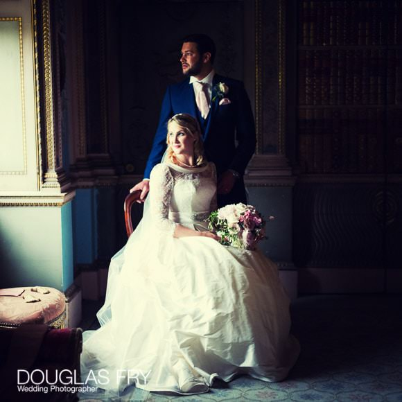 romantic photograph by window of bride and groom at Syon Park