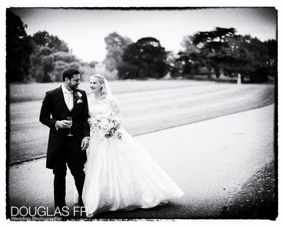 Black and white photograph of bride and groom outside at Syon