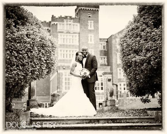 Sepia photograph of bride and groom in front of Selsdon Hotel