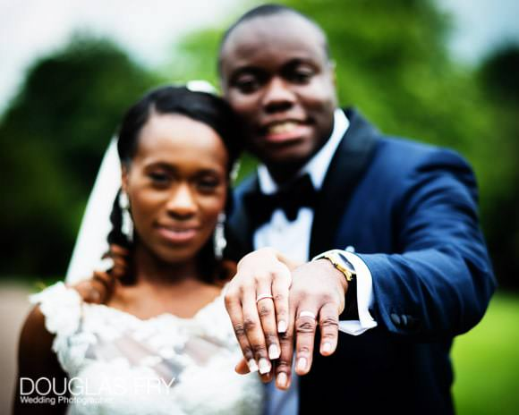 Bride and groom in colour showing their wedding rings